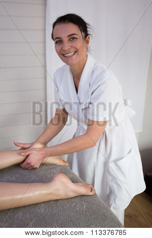 Smiling Caucasian Pedicurist Working With Client At Spa.