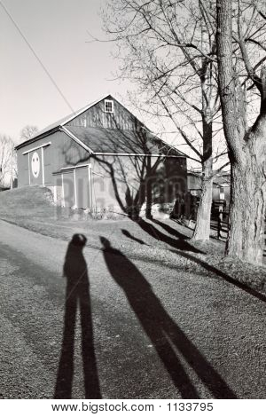 Two Shadows And The Farm House