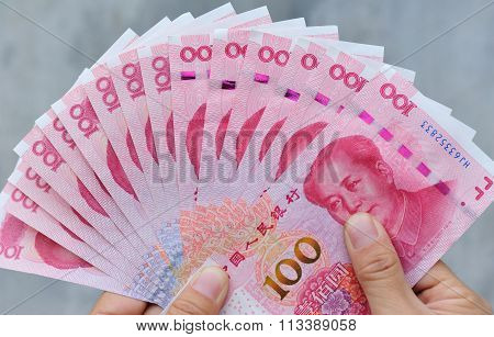 closeup of people hand with cny cash