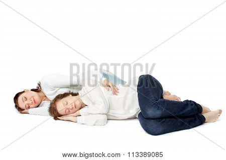 Young happy couple sleaping over white background