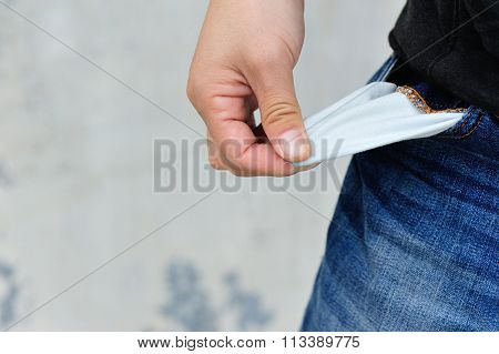 young woman show her pocket has no money