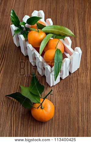 Ripe Tangerines With Leaves In A Box