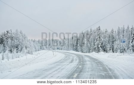 Windy road in Ruka in Finland on the Arctic pole circle in winter poster