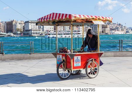 ISTANBUL, TURKEY - APRIL 10, 2015: unidentified person with a snack stall at the Golden Horn in Istanbul. Istanbul is the largest city in Turkey and a famous travel destination