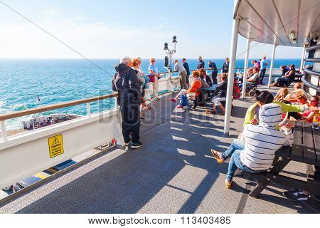 DOVER, ENGLAND - JULY 10, 2015: on a DFDS ferry from Dover to Dunkerque with unidentified people. DFDS is Northern Europes largest shipping and logistics company. It was founded in 1866