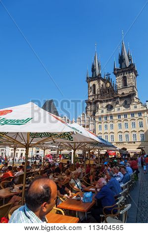 PRAGUE, CZECHIA - SEPTEMBER 05: Tyn Church with unidentified people at the Old Town Square on September 05, 2014 in Prague. The church is the main church of the Old Town since the 14th century.