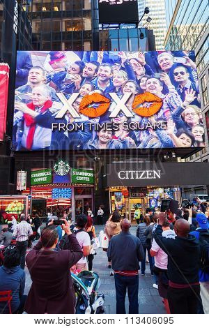 NEW YORK CITY - OCTOBER 06, 2015: big screen at Times Square with unidentified people. It is one of the worlds busiest pedestrian intersections and a major center of worlds entertainment industry