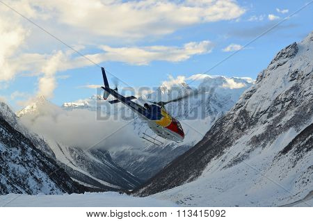 Flying helicopter between mountains in the Himalayas