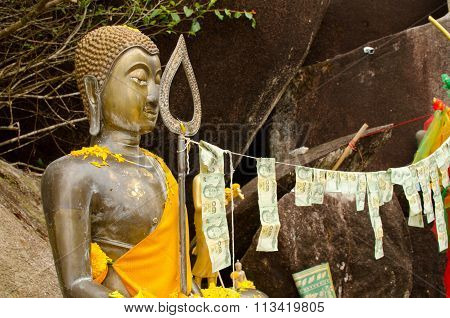 Buddhist Statue With Offerings