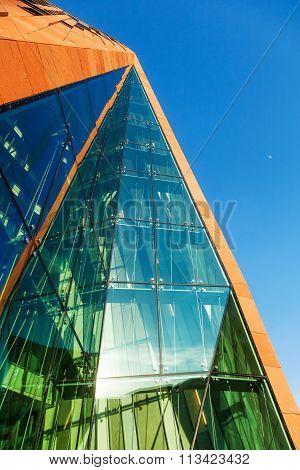 HAMBURG, GERMANY - MARCH 08: Sumatra building in the Ueberseequartier of the HafenCity on March 08, 2014 in Hamburg. It is designed by Erick van Egeraat and part of the city-planning project Hafen-City