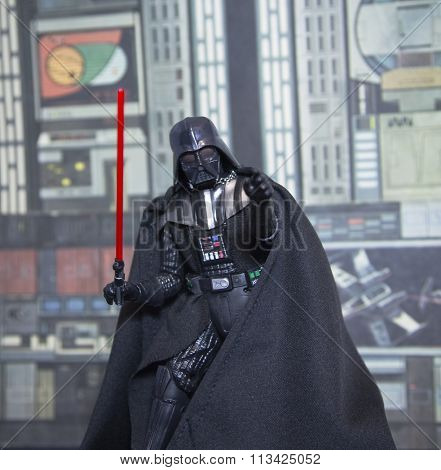 BLOOMFIELD, NEW JERSEY - JAN 3, 2016: Hasbro Black Series Darth Vader action figure recreating a scene from Star Wars.  Darth Vader is also known as Anakin Skywalker, father to Luke and Leia Organa