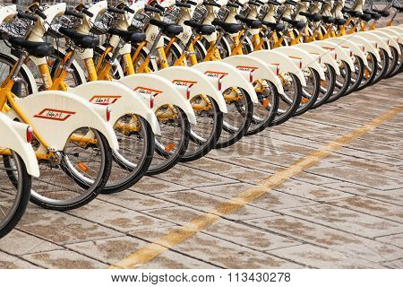 MILAN, ITALY - FEBRUARY 20: BikeMi bicycle station on February 20, 2014 in Milan. BikeMi is a bicycle sharing system in Milan with 3240 bicycles and 183 stations and more than 5000 users the day.