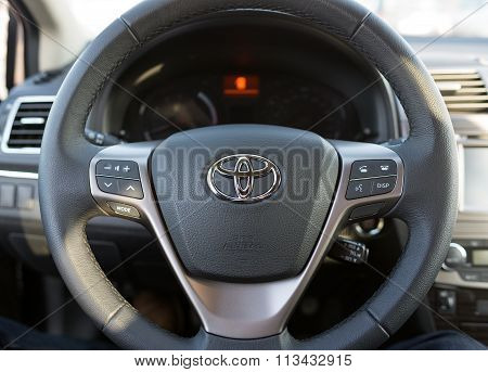 Steering wheel  and front console closeup of Toyota Avensis