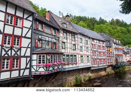 MONSCHAU, GERMANY - AUGUST 23, 2015: old buildings in the small town Monschau. The historic town center has many half-timbered houses and narrow streets remained nearly unchanged for 300 years