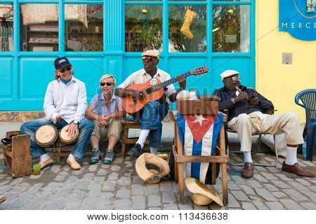 HAVANA,CUBA - JANUARY 5, 2015 : Senior cuban men playing traditional music in the streets of Old Havana