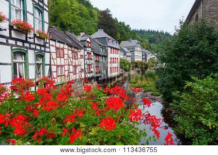 old half timbered houses at the river Rur in the picturesque Eifel town Monschau in Western Germany