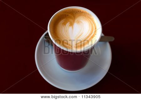 Cup Of coffee With Drawing Heart On Scream  (macro)