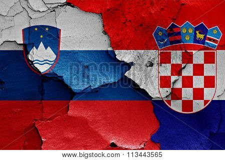 Flags Of Slovenia And Croatia Painted On Cracked Wall