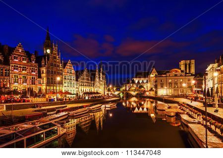 GHENT, BELGIUM - SEPTEMBER 01, 2015: Graslei at night with unidentified people. Ghent is famous for the medieval old town and is Belgiums 2nd largest municipality by number of inhabitants