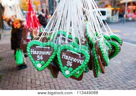 HANVOER, GERMANY - DECEMBER 03, 2015: gingerbread hearts with the lettering of the soccer club Hanover 96, which play in the Bundesliga, the top tier in the German football league system
