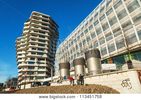 Hamburg, Germany - March, 2014: Marco Polo Tower with unidentified people. It is located in the development area HafenCity and is designed by Behnisch architects.