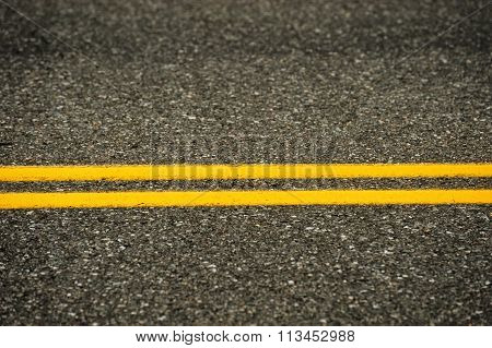 double yellow line on asphalt street surface