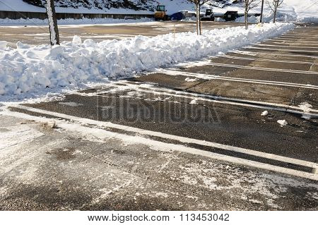 empty parking lot with snow removed