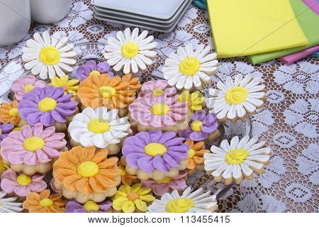 Flower Sugar Cookies on large plate white lace table cloth