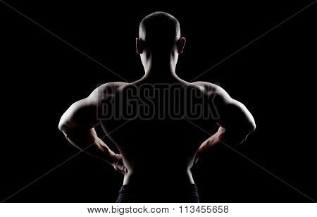 bodybuilder demonstrates latissimus dorsi.