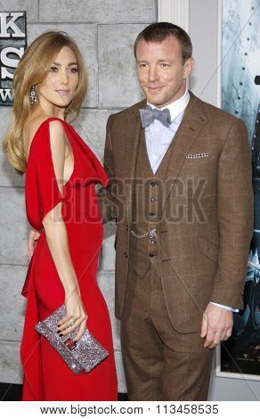 Jacqui Ainsley and director Guy Ritchie at the Los Angeles Premiere of