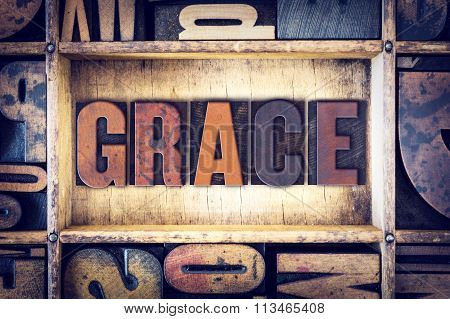 "The word ""Grace"" written in vintage wooden letterpress type. poster"