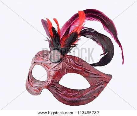 Venetian red Carnival half mask with feathers, isolated on white background
