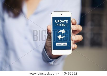 Update phone message in a mobile screen. Woman showing a mobile phone. poster