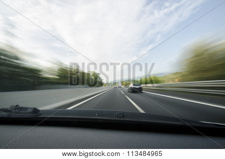 Car Overtaking On A Motorway