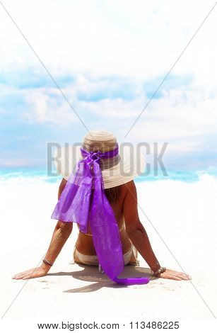 Happy woman enjoying beach relaxing joyful in summer by tropical blue water.