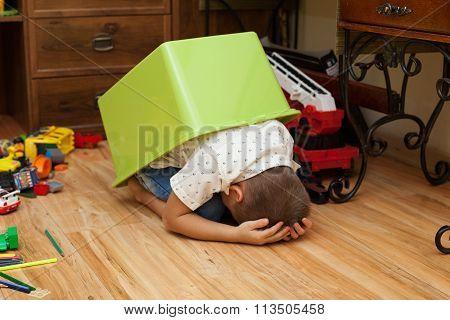 Little Boy Hiding In A Box