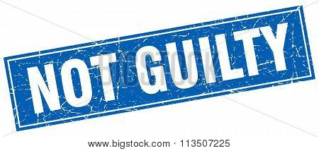 Not Guilty Blue Square Grunge Stamp On White