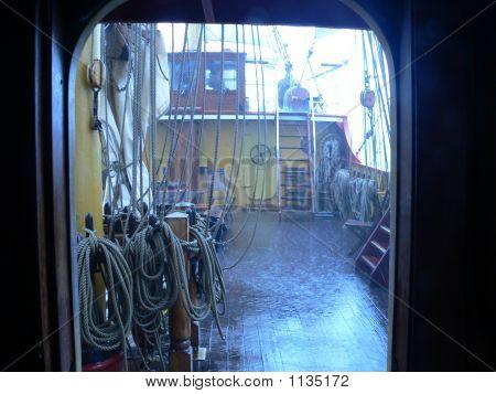 stormy deck rain and wind through deckhouse door poster