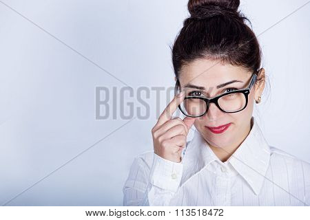 Business woman with glasses.Young bussines woman holding glasses looking throw them.