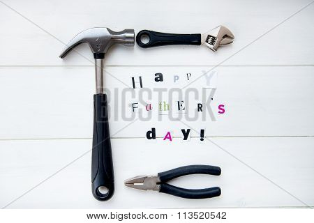 Happy Fathers Day Letters Cut Out From Magazine And Tools