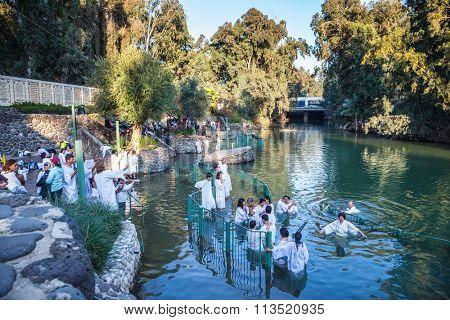 YARDENIT, ISRAEL - JANUARY 21, 2012: Christian pilgrims enter Jordan River waters. They make  baptism ceremony in honor of Jesus Christ's baptism here