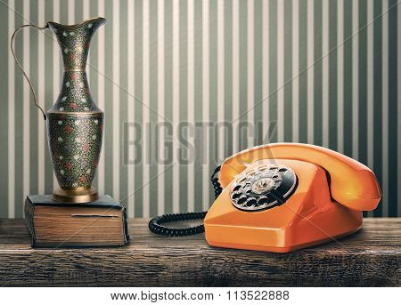 Vintage Phone, Vase And Book On A Table
