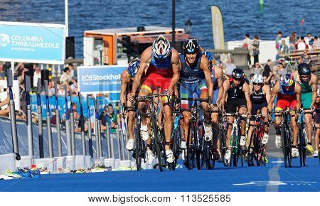 STOCKHOLM SWEDEN - AUG 23 2015: Stuggeling triathlon competitors including Fernando Alarza and Facchinetti cycling uphill in the Men's ITU World Triathlon series event August 23 2015 in Stockholm Sweden