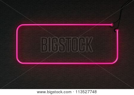 Pink neon frame isolated on black wall background