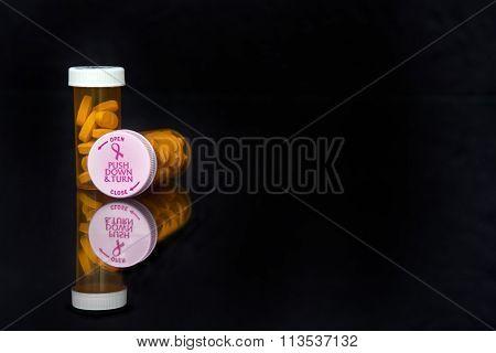 Breast cancer awareness lid with pink ribbon on prescription drug vial for october. poster