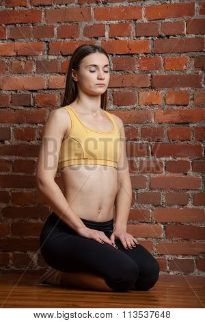 Attractive Woman Meditating With Closed Eyes