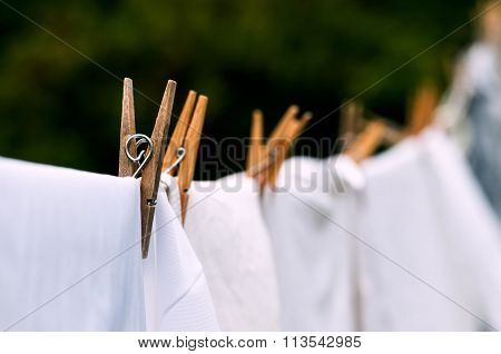 Eco-friendly washing line white laundry drying outdoors