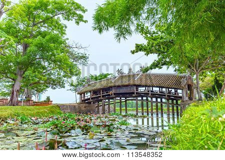 Thanh Toan tile bridge calm river