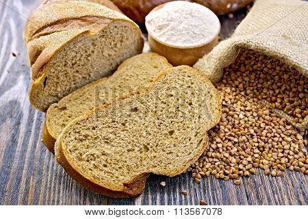Bread buckwheat with cereals and flour on board