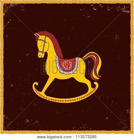 Rocking horse on brown background